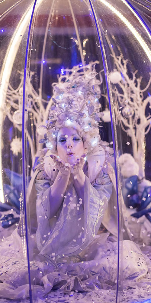 Living Snow Globe act entertaining at a Christmas event