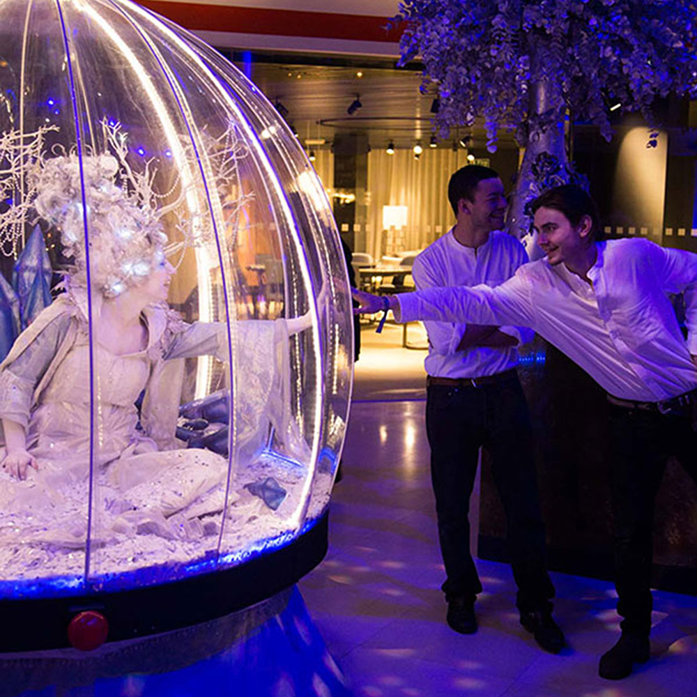 Living Snow Globe act meeting the Christmas party bar staff!