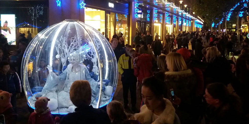 The Living Snow Globe gliding through the crowds for Cardiff's Christmas light switch-on