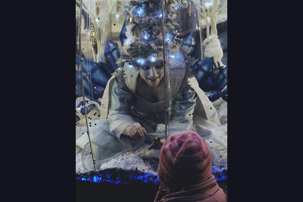 Illuminated snow queen in her Living Snow Globe