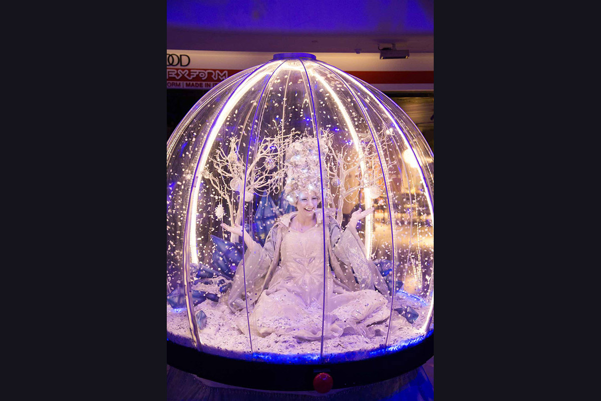 Living Snow Globe act at a Christmas party in Chelsea, London