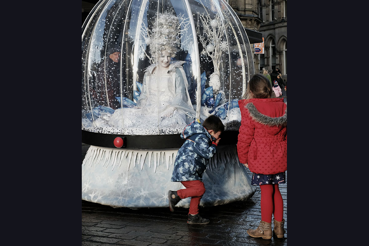 Living Snow Globe act, unique winter event entertainment