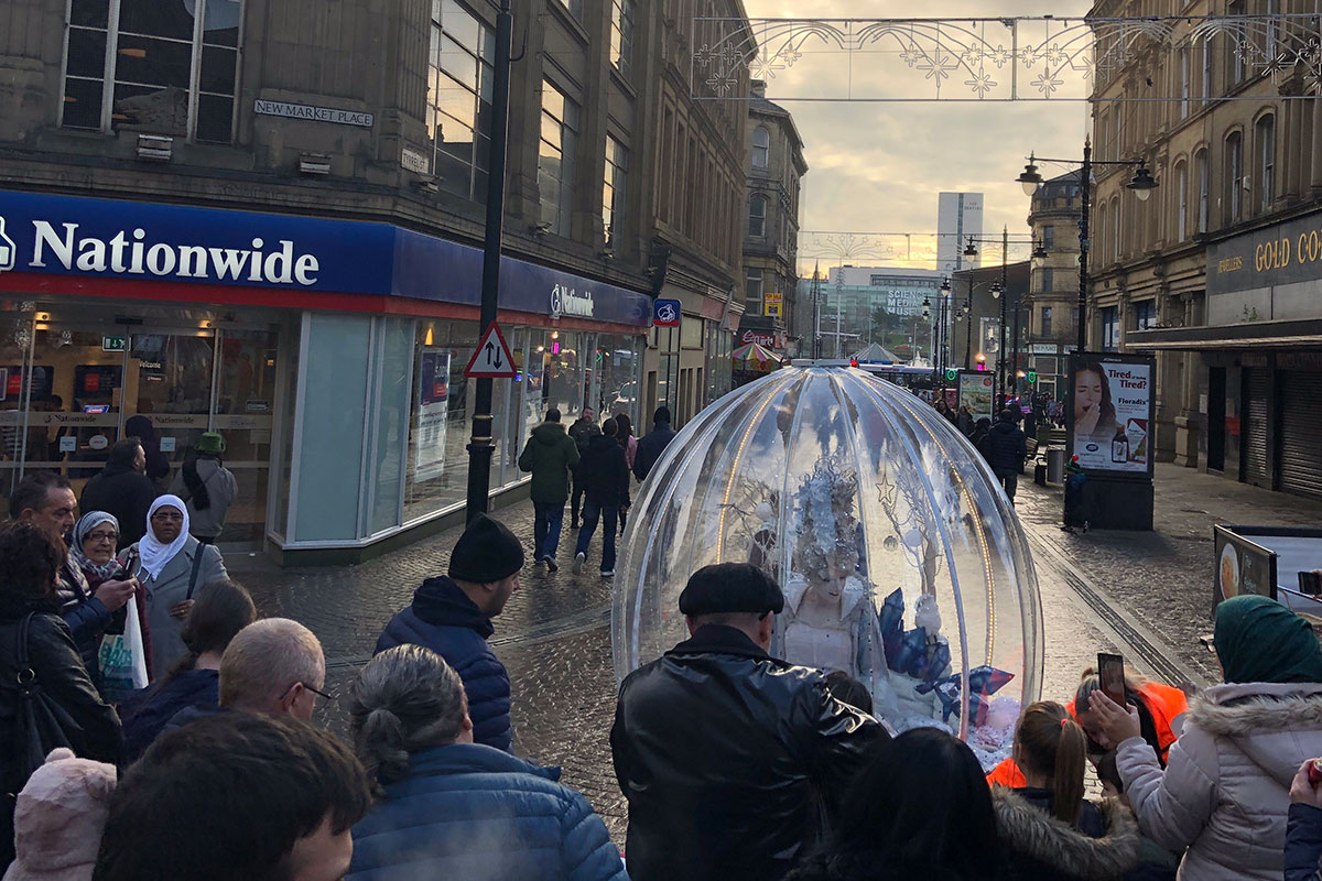 Performing Living Snow Globe act in Bradford