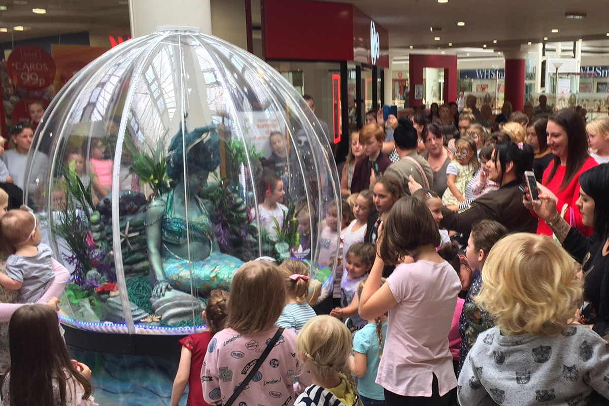 Sea Sphere mermaid act in Intu Potteries shopping centre