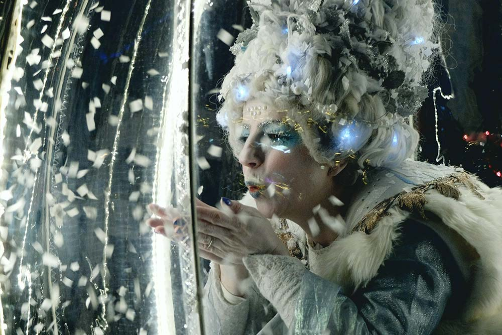 Living Snow Globe Queen blowing snowflakes